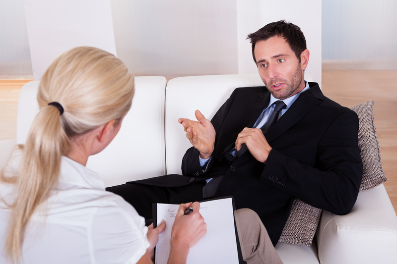 Man in conversation with therapist